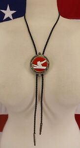 Leslie Brown Bolo Tie Hatchet & Wood Red Background Silver Plated Bolo Tie