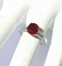 Pigeon Blood Ruby set in platinum with Taper baguette Diamonds size 5