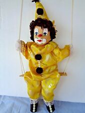Shalom Porcelain Face String Clown Puppet Sitting on a Swing Vintage Gold Satin