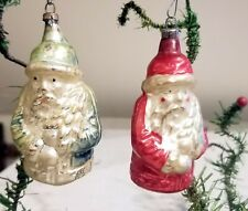 Blue Suited Santa. Red Coated Santa, Trees. Two 1920s German Glass Ornaments