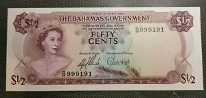 1965 Bahamas 1/2 Dollar Note Crisp Uncirculated Condition. A young QEII..