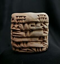 near eastern, A terracotta cuneiform clay tablet, oldest form of writing.