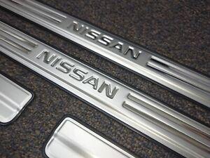 New genuine Nissan Navara stainless Scuff plates -set of 4