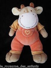 Doudou Vache en salopette orange avec coeur Mots d'Enfants 22 cm