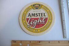 ~AMSTEL LIGHT~CARDBOARD BEER COASTER~PRINTED IN GERMANY~
