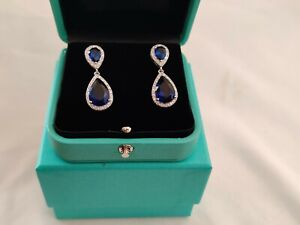 White gold finish blue sapphire pear cut and created diamond droplet earrings