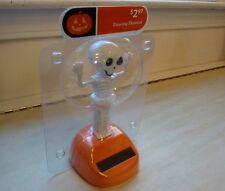"""Halloween solar dancing skeleton, approx. 6"""" inches total height, white & orange"""