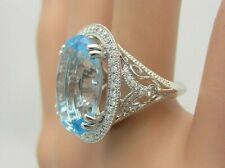 14K White Gold 13.87 Carat Blue Topaz and Diamond Ring Halo