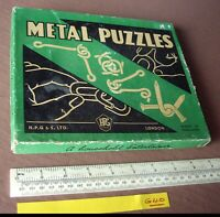 Vintage 1950s/60s period Gibson London Metal Puzzles. Box of 12.   (G40)