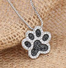 Collier, pendentif motif patte d'animal argenté et noir, chien, chat.