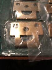 Deltana Surface Bolt Strike Plate Brass Polished. Curved Lip