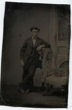ANTIQUE TINTYPE  HANDSOME YOUNG MAN WILD HAIR TINTED CHEEKS  PAINTED BACKGROUND.