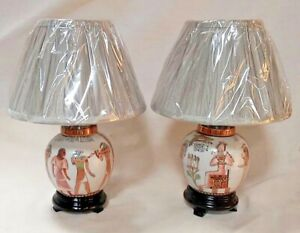 Pair of Egyptian porcelain lamps complete with grey fabric shade