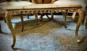 Onyx coffee table with ornate brass legs