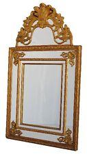 Glace à pare-close de style régence en bois doré