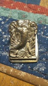 ANTIQUE HEAVY BRASS PAPER/BILL CLIP, TUSKED AFRICAN ELEPHANT IN JUNGLE PLANTLIFE