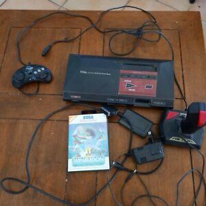 Master System 1, cables, joystick, 1 manette, 3 jeux