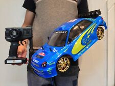 RC RADIO REMOTE CONTROL MASSIVE 1/10 CAR SUBARU FAST SPEED RECHARGEABLE RTR UK