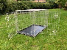 Folding Metal Dog Crate, Medium / Large size. Has plastic base tray, 2 doors