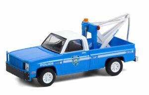 GREENLIGHT NEW YORK CITY POLICE NYPD - 1987 GMC SIERRA K2500 TOW TRUCK [PRESALE]