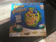 GONE FISHING GAME CATCH A FISH AS THE BOARD GAME ROTATES NIB ALSO HAVE TOY STORY