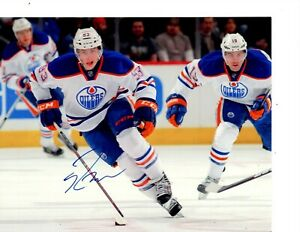 RYAN NUGENT HOPKINS EDMONTON OILERS SIGNED BREAKOUT WITH PUCK 8X10