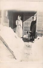 DEEP SNOW~WOMEN IN SCARVES~ON FRONT PORCH~BLACK-EYED DOG~ REAL PHOTO POSTCARD