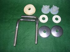 A PACK OF STAINLESS STEEL TOILET SEAT FIXINGS.