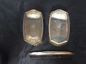 Vanity set, 2 vintage brushes and comb all marked sterling. Ds17