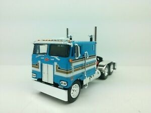 """1/63 DCP/FG Blue Graphics 352 Peterbilt 110"""" Cabover Tractor"""
