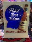 1940'S METAL AND PLASTIC PABST BLUE RIBBON BEER BACK BAR SIGN