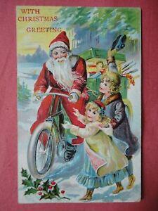 FATHER CHRISTMAS EMBOSSED POSTCARD SANTA CLAUS BICYCLE 1909 HIGHBRIDGE SOMERSET