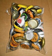100 MIXED USED BEER BOTTLE CAPS. FOR YOUR CRAFTS PROJECTS.