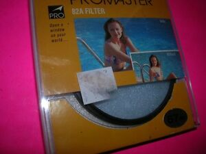 PROMASTER UNUSED 67MM FILTER 82A PERFECT BOXED FOR NIKON PENTAX 67 CANON
