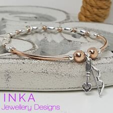 Inka 925 Sterling Silver Stacking Bracelet Rose gold Beads and Cupids Bow charm