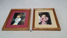 Framed Art set, two mesmerizing children, boy (in blue), girl (in pink) with toy