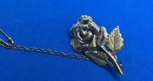 SILVER COLOURED FLOWER BROOCH WITH SAFETY CHAIN