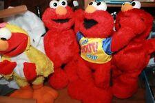 Lot of 4 Elmo toys - shout elmo, rolling elmo, chicken elmo and TMX elmo