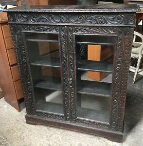 Vintage Antique glass fronted book case display cabinet black carved oak?