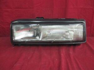NOS OEM Oldsmobile Calais GT Headlamp light 1987 Left Hand Black Trim
