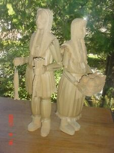 PAIR OF LARGE VINTAGE CHEROKEE INDIAN CARVED WOOD AND CATTAIL TULE FIGURES
