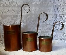 Three Copper Measures With Brass Measurement Labels And Handles