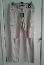 New with tags Ladies ripped beige/cream stretch skinny jeans. Size 8.