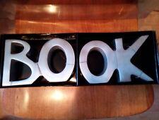 Serre livres BOOK en aluminium poli