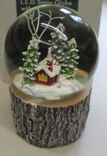 More details for christmas colour changing snow globe with trees & church with swirling snow 15cm