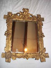 miroir ancien 19éme bois et stuc décor feuillage.