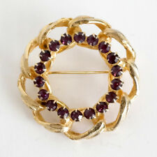 Gold plated round shape pin brooch with prongs set amethyst color rhin... Lot 69