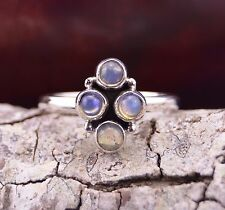 Four small round Rainbow Moonstones set in a Sterling Silver ring size 9