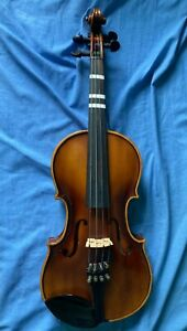 3/4 size used unbranded Violin in good condition with vintage Roth case