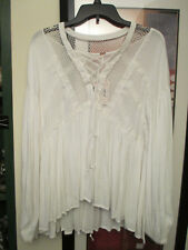 Adorable angel wing effect top by Free People,Ivory combo,size M,sold at $128.